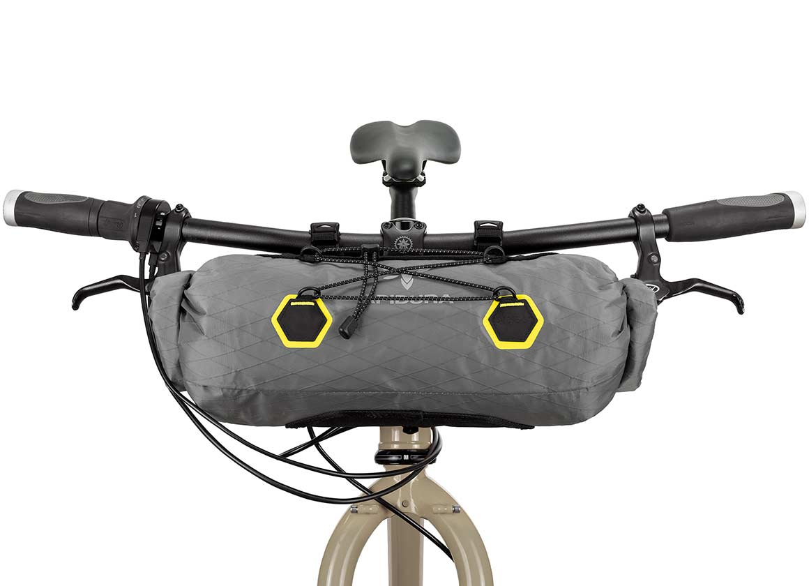 BACKCOUNTRY HANDLEBAR PACK (9L) - The Backcountry Handlebar Pack is designed to carry light, compressible items on long distance rides and multi-day adventures.