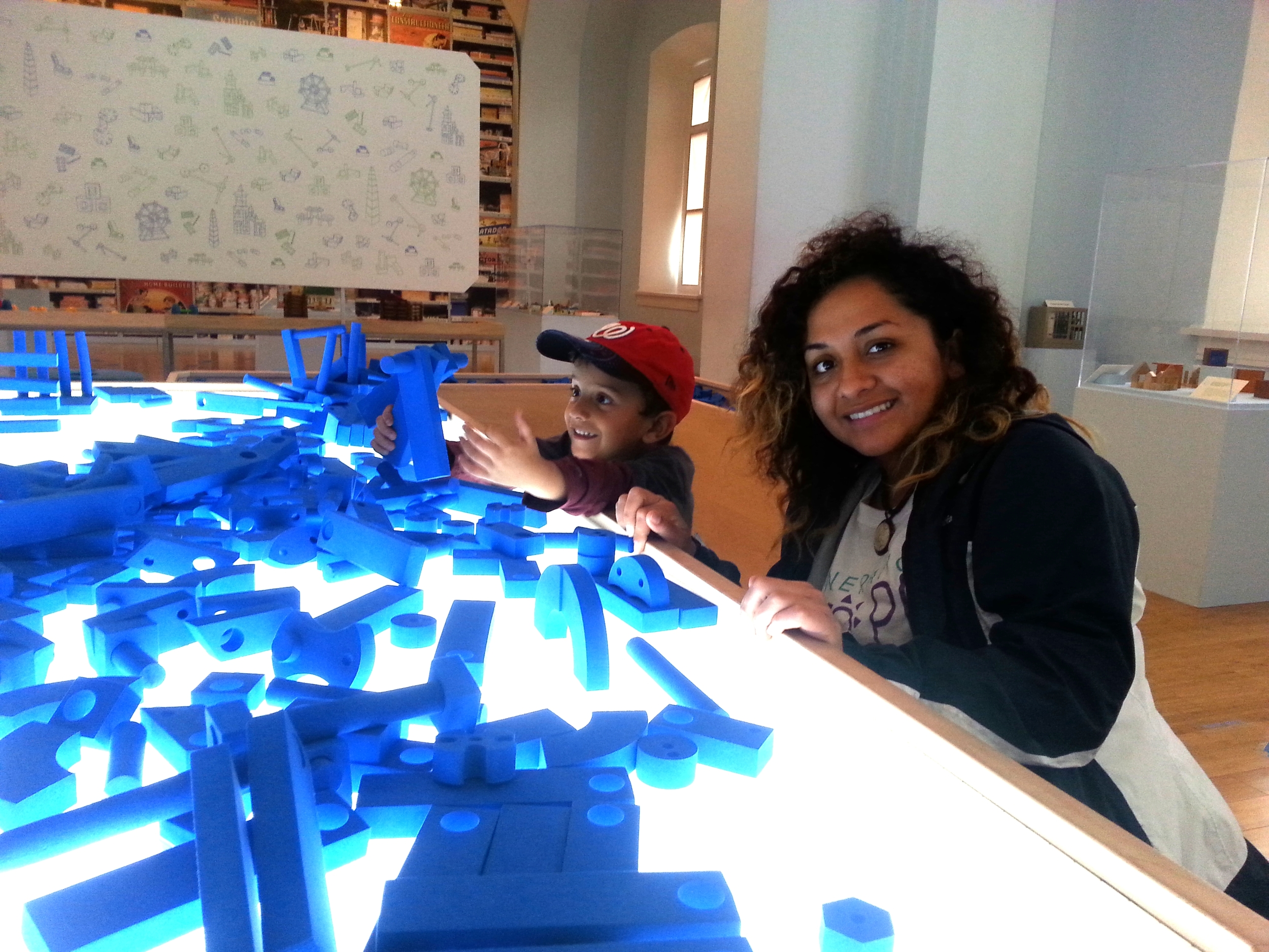 Scholar Emerita and her son enjoy the Building Zone at the National Building Museum during our fall field trip.