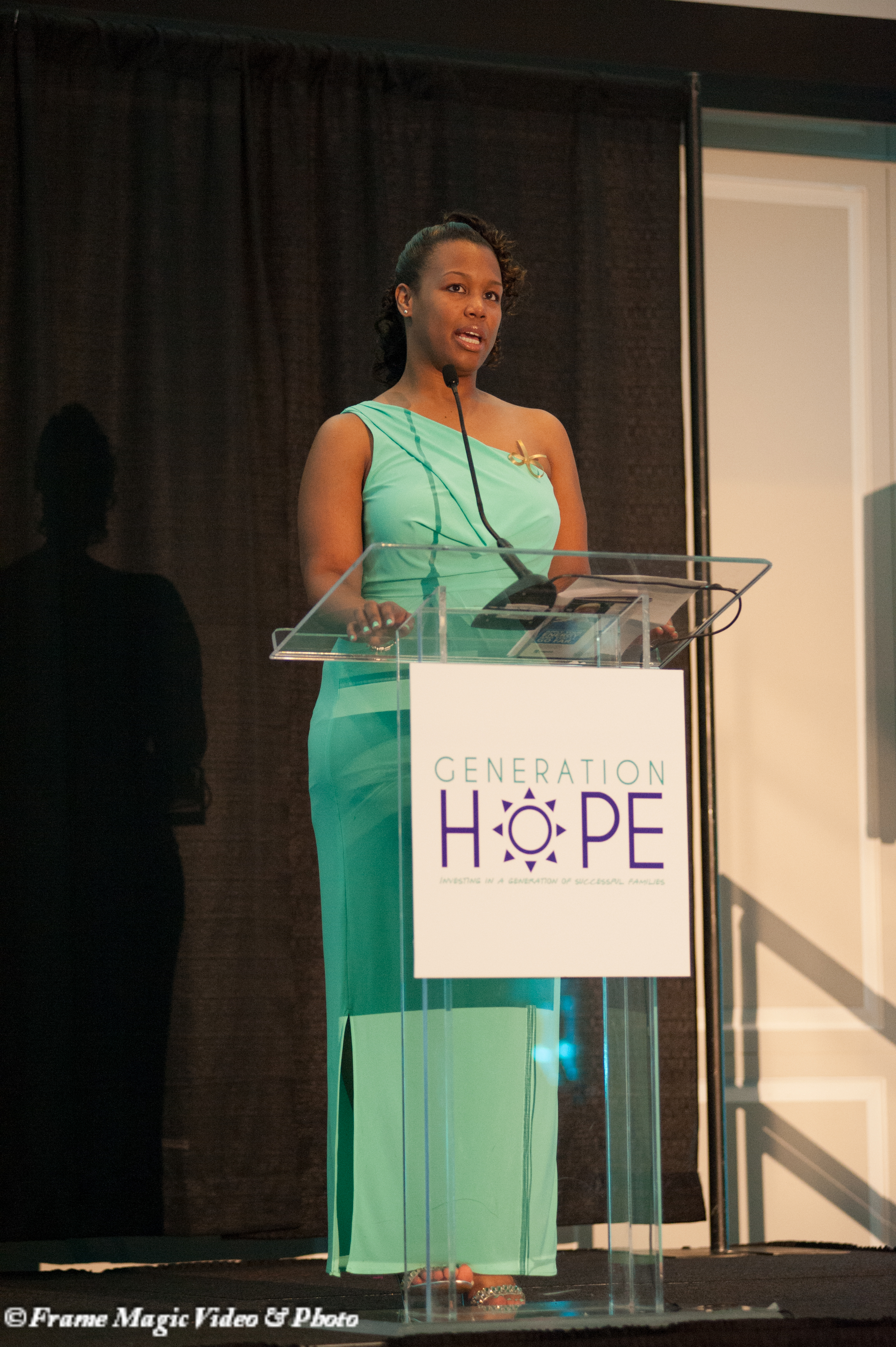 "Ericka speaking at Generation Hope's 2014 ""Pep Rally Under the Stars"" Gala (Photo: Frame Magic Video & Photo)"
