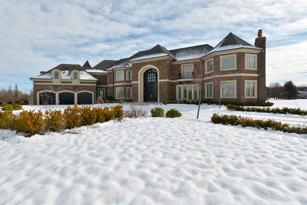 A house at the Estates at Green Fields in Old Brookville, N.Y., a development designed with Chinese buyers in mind. Indeed, the house above was snapped up by a Chinese buyer.     Credit Kathy Kmonicek for The New York Times