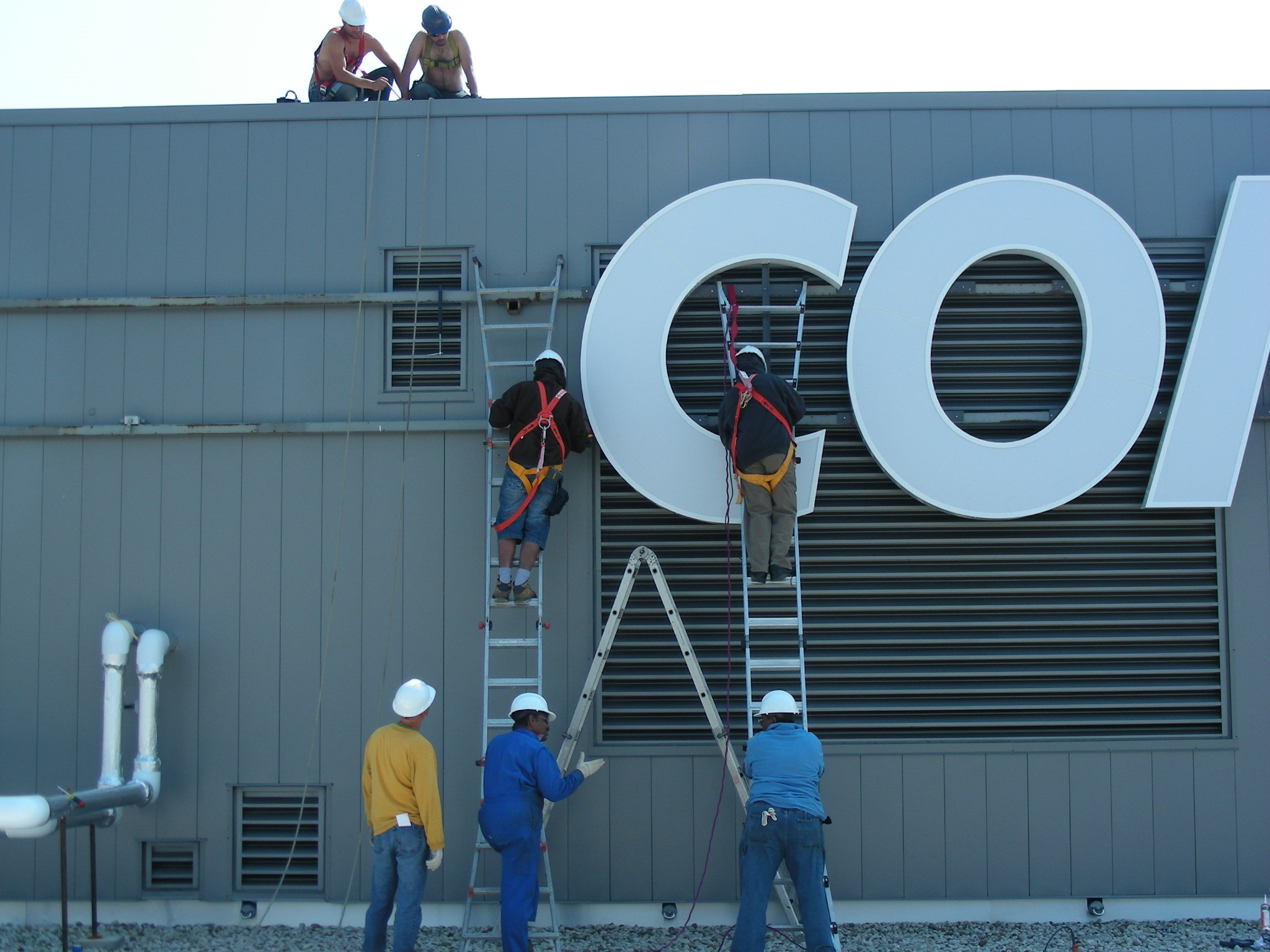 12 ft High LED Lit Channels Letters being installed
