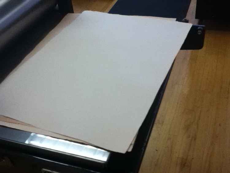 Here is the wood colored paper after is has been pressed and dried. Next, I applied the wood grain.