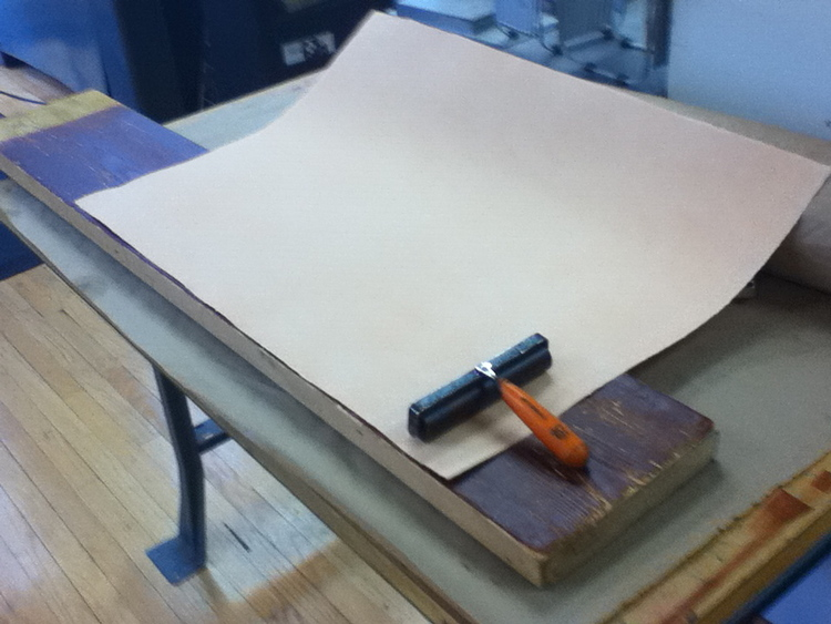 I placed my wood colored paper on the inked wood and hand-roll pressed it with a brayer.
