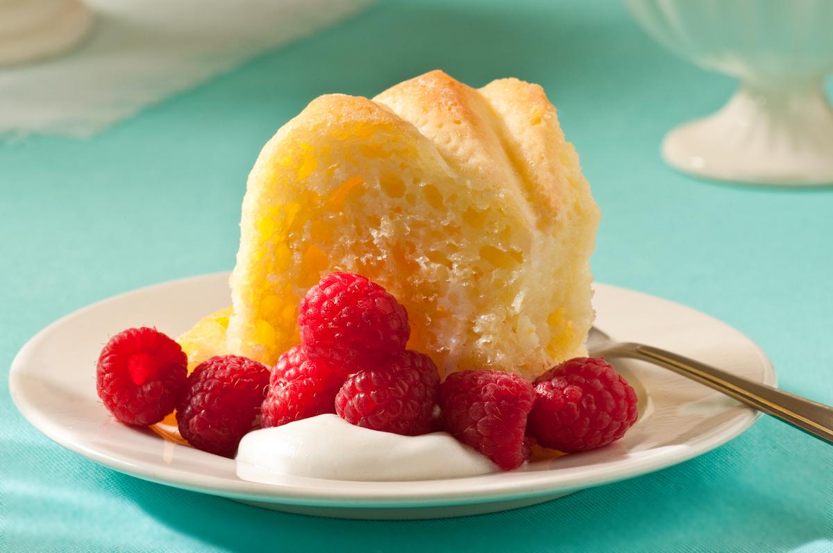 slice of savarin with cream and berries