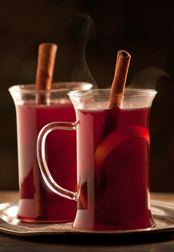 two mugs of steaming spiced mulled wine