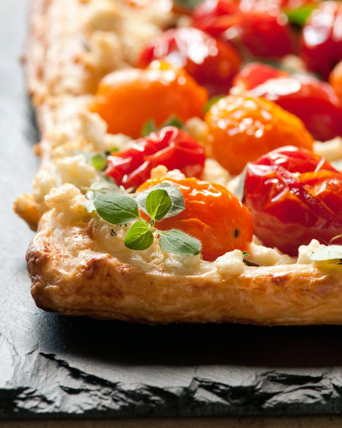 fresh oregano on tomato tart
