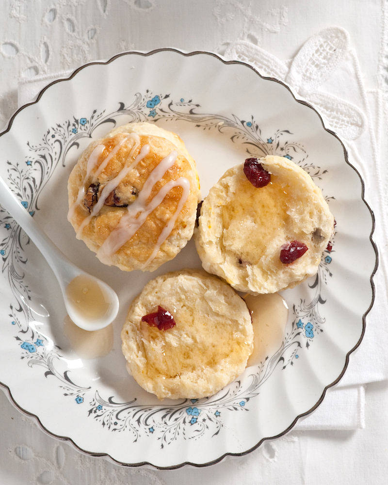 scones with honey on vintage china