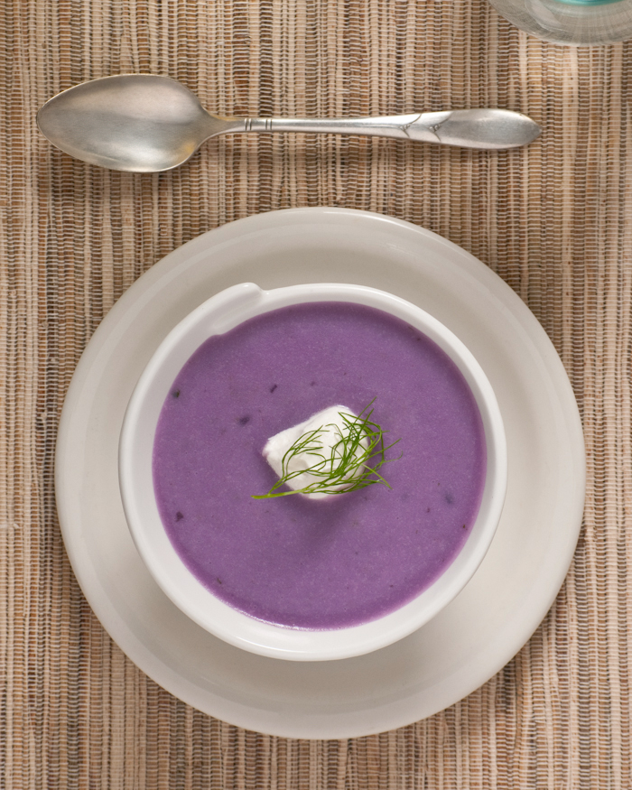 purple potato and fennel soup garnished with creme fraiche