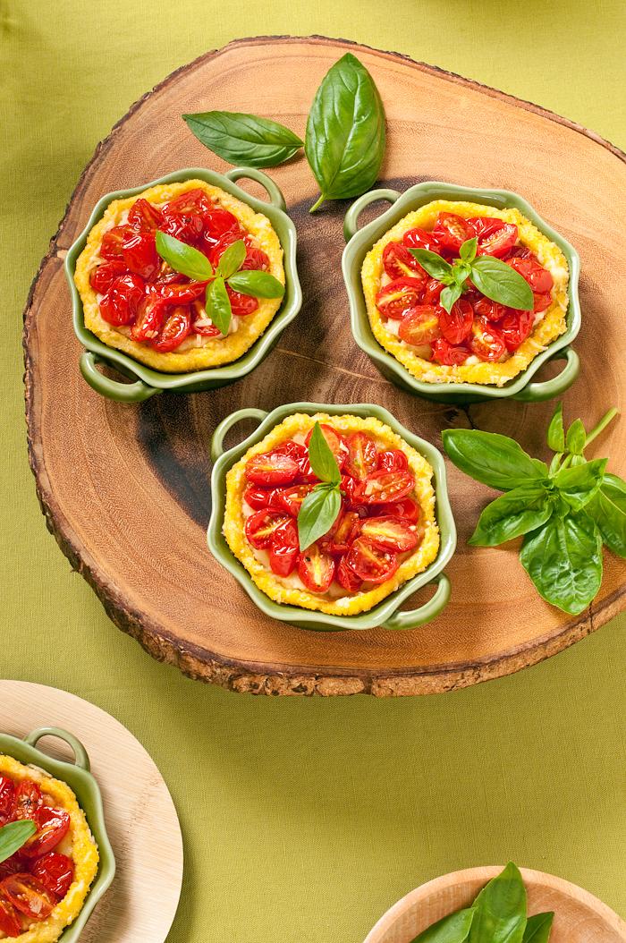polenta tarts filled with honey roasted tomatoes and feta