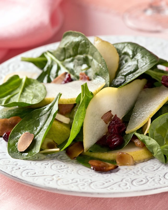 healthy green salad with pears cranberries and almonds