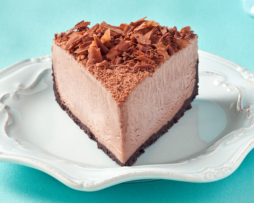 Icy shades of blue contrast with the chocolate brown tones in this slice of  Frozen Mochachino Cheesecake . The cool blue palette also offers a visual cue to the frozen nature of the dessert.