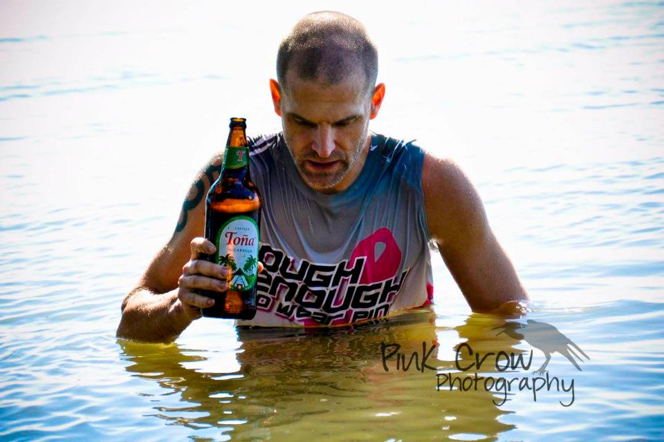 Mark Connolly takes a dip in Lake Nicaragua with a Toña after the 2012 Fuego y Agua 50k