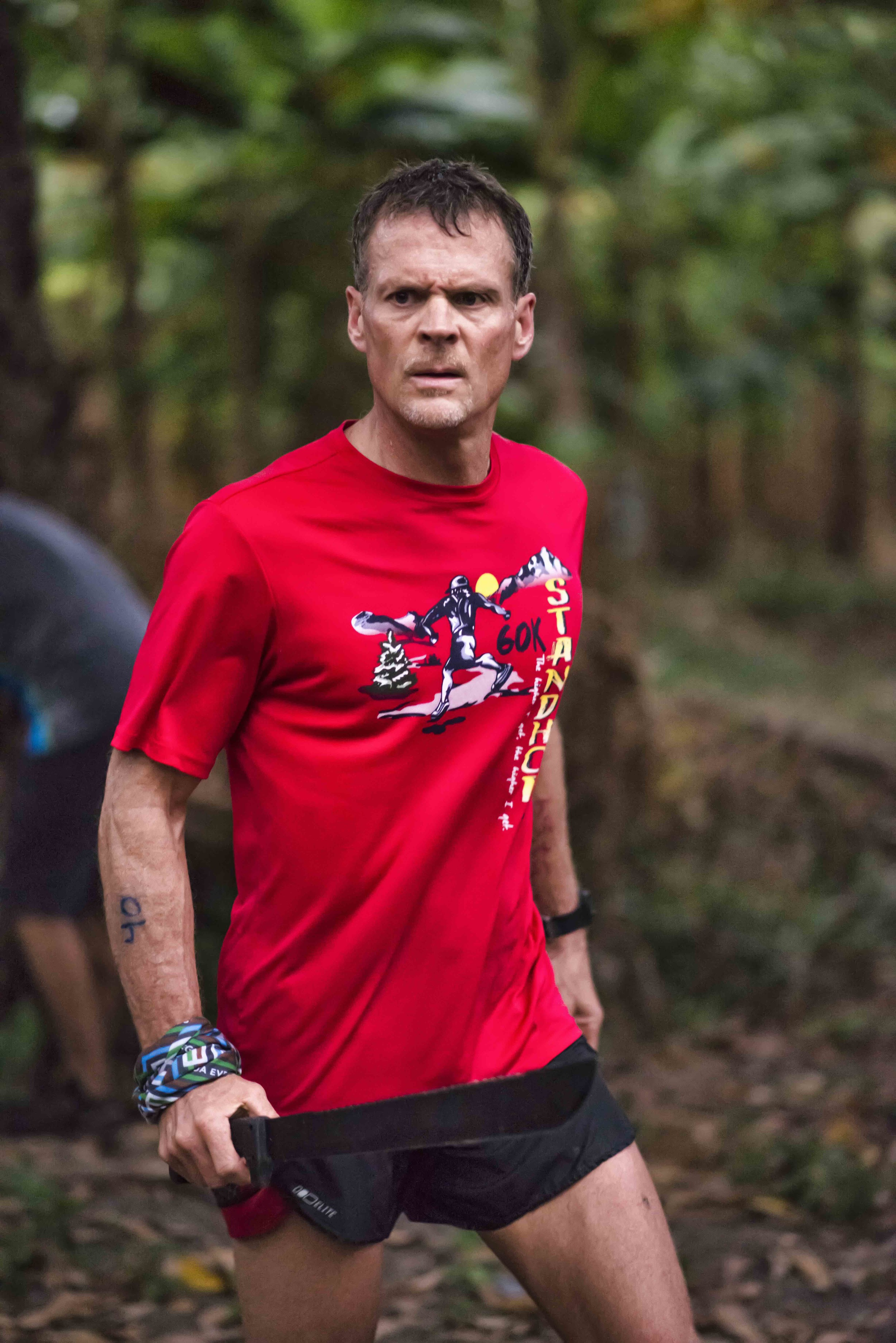 Mark Wheeler harvesting plantains during the Survival Run. Mark finished the Survival Run and the 100k, becoming one of two Devil's Double finishers in 2015  Photo by Jeff Genova Photography