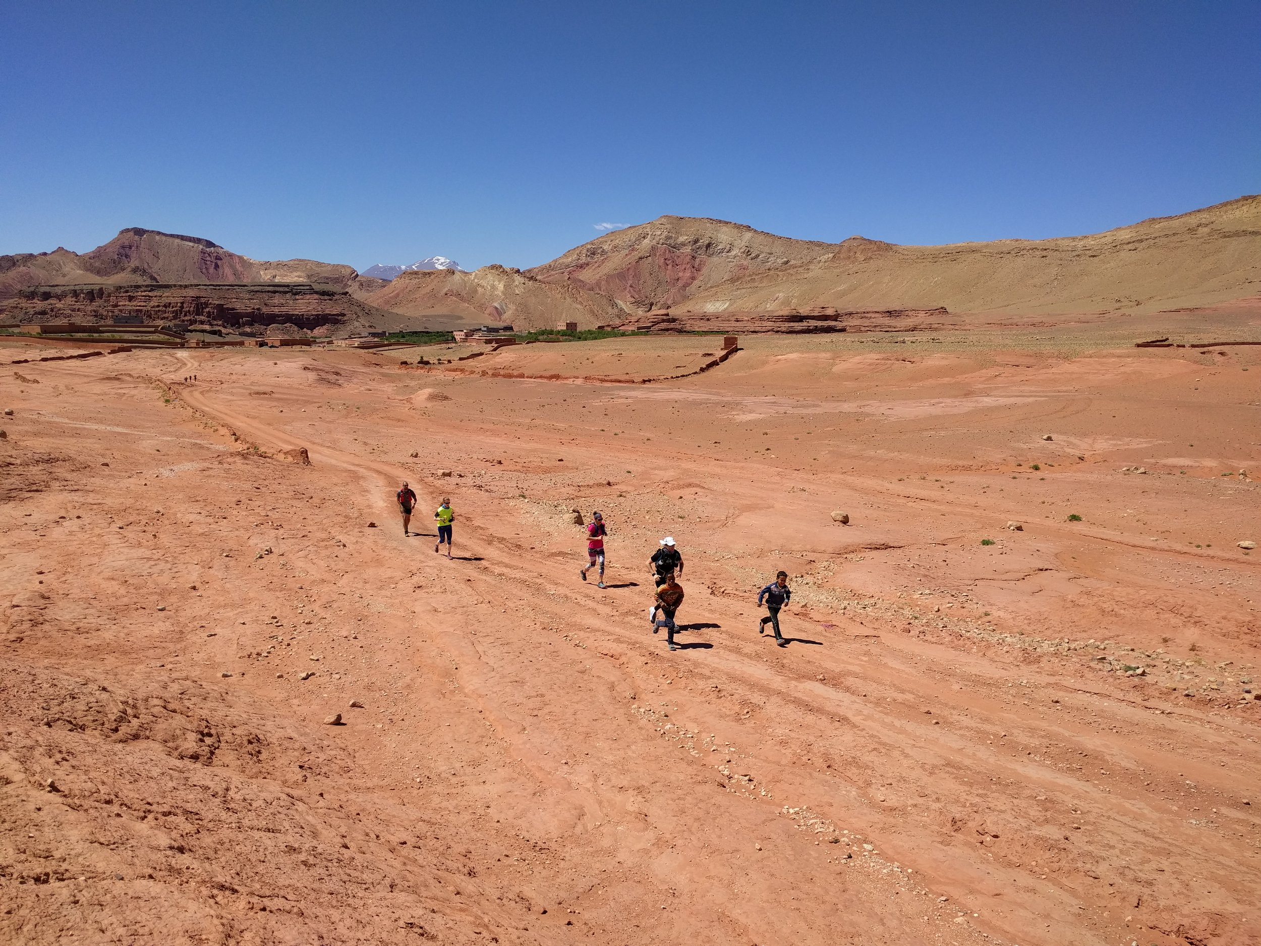 Local kids pacing our runners on Day 2 in the high desert.