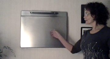 My mother with her circa 1950's GE Oven Door which hangs on her wall as an art piece.