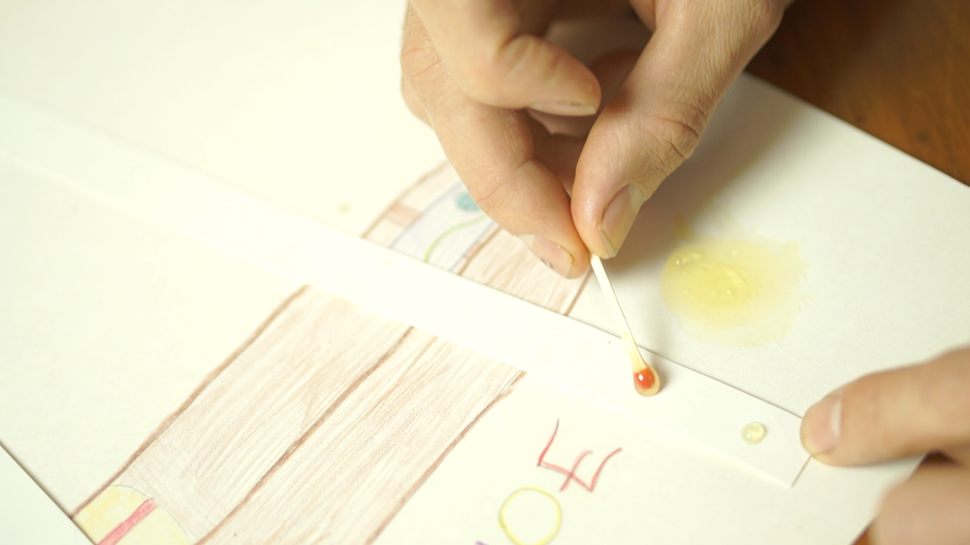Use a match to put little dots on the cardboard as rivets