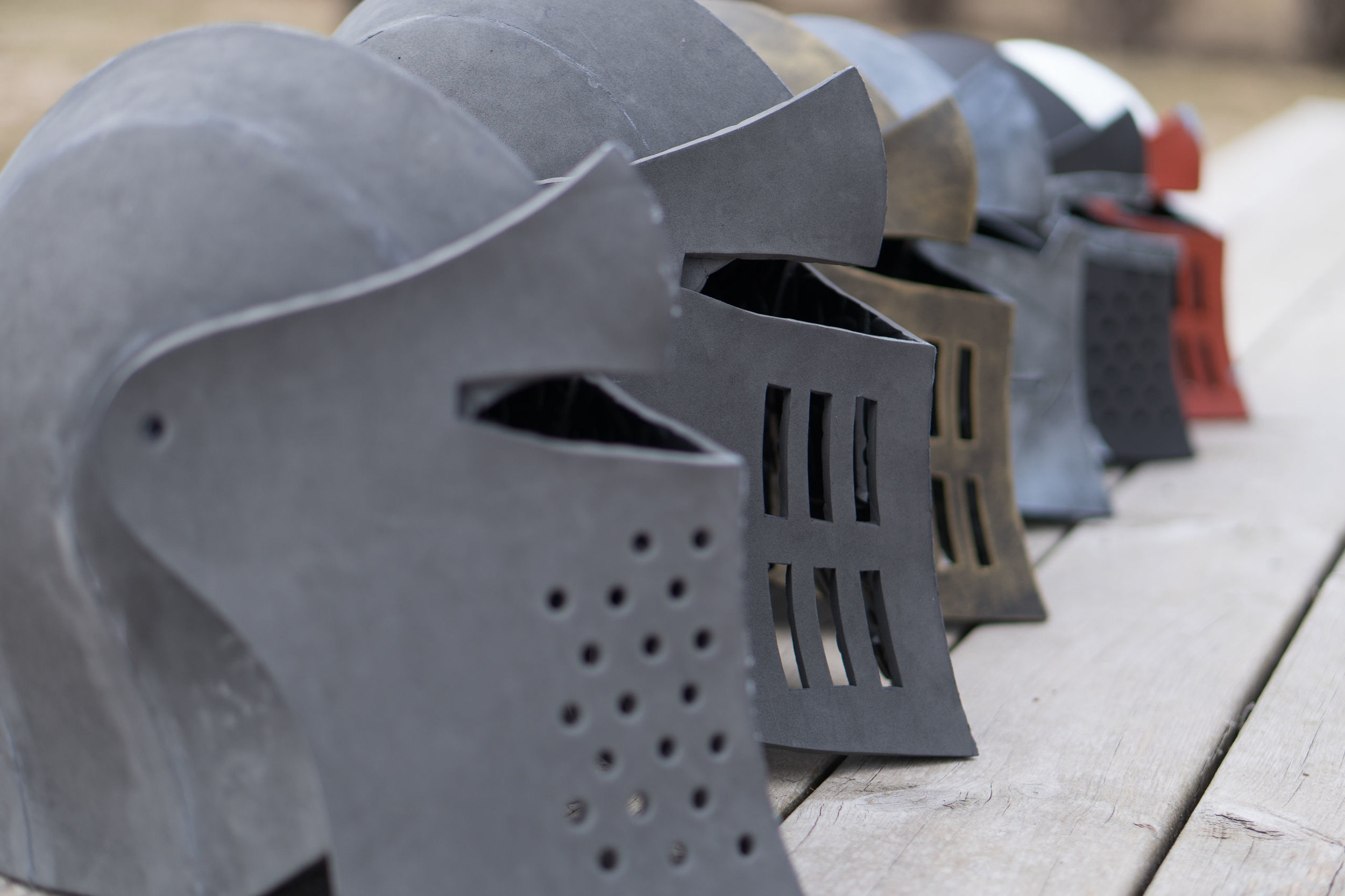 All the different knight helmet sizes lined up, ready to go.