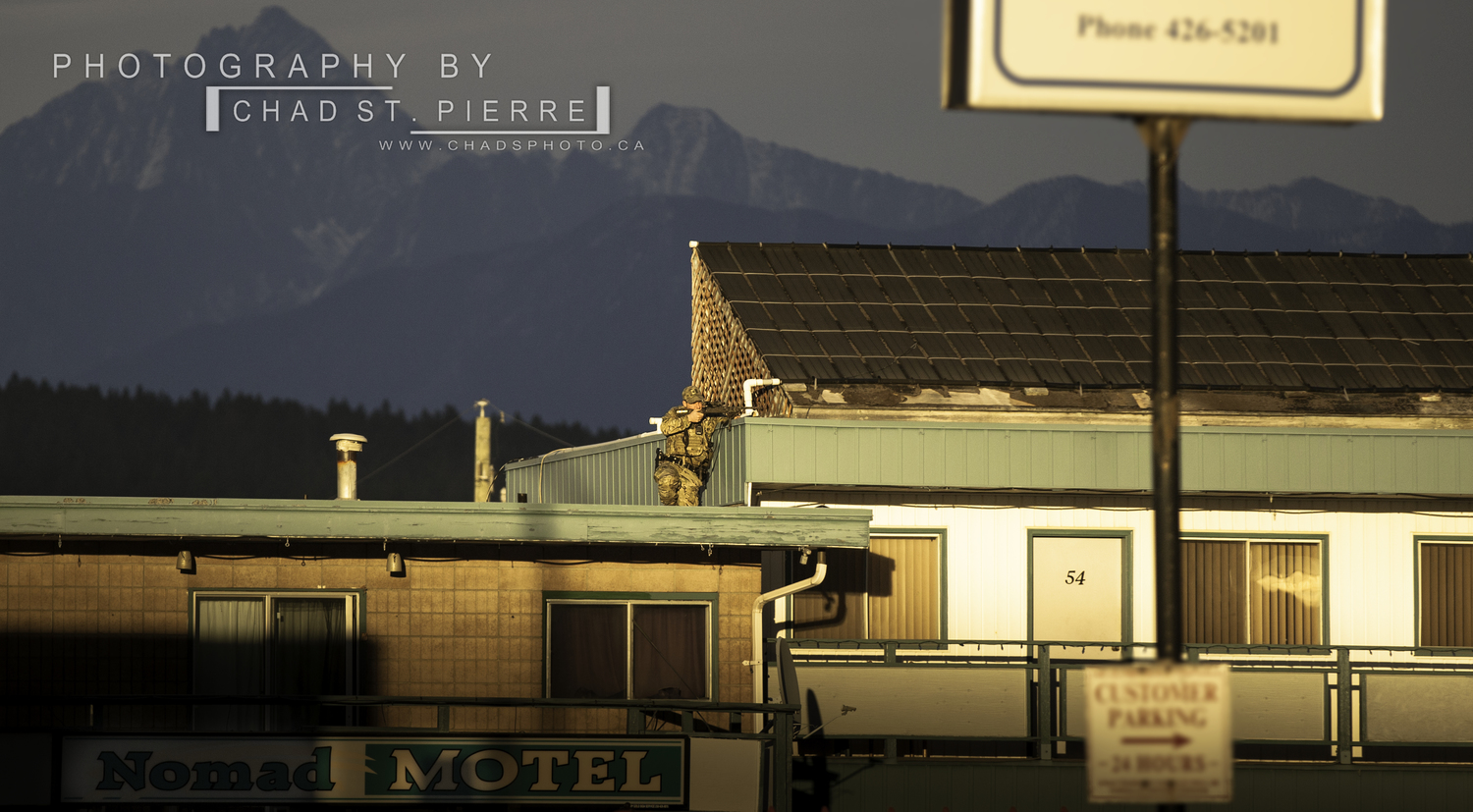 Emergency Response Team called to man isolated in motel - A marksman from the Emergency Response Team (ERT) takes up position on the Nomad Motel upper level in Cranbrook while a man barricades himself in one of the rooms.