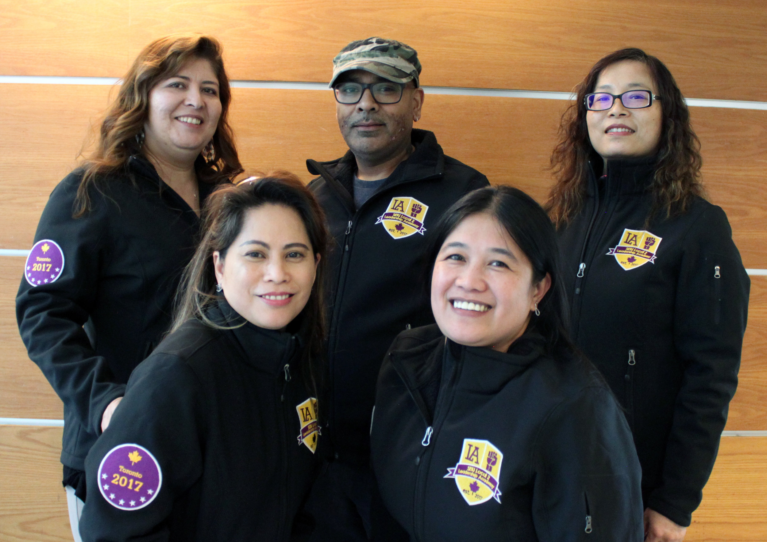 Toronto Area Leadership Academy graduates show off their new jackets.