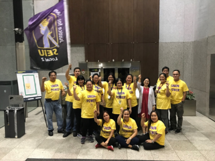 """Janitors at the 401 West Georgia building celebrate a 100% """"Yes!"""" vote after casting their ballots on September 12"""