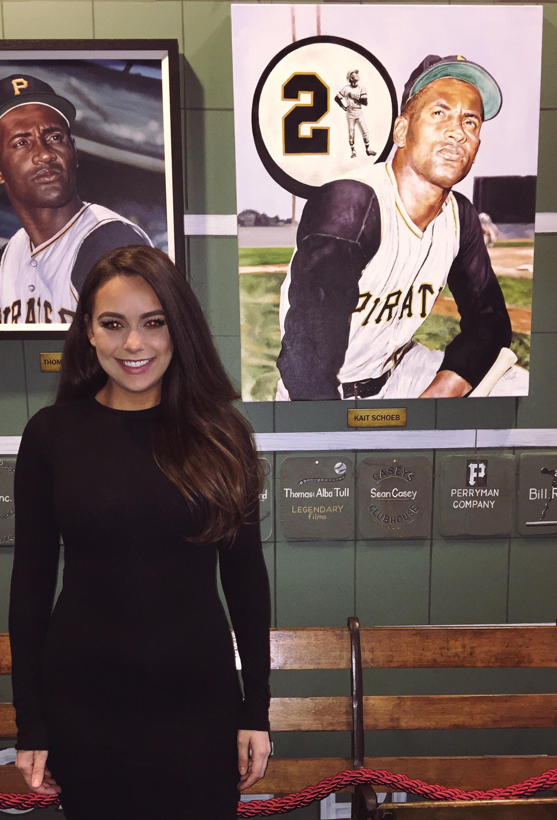 Kait with her painting, currently hanging in the Roberto Clemente Museum in Pittsburgh
