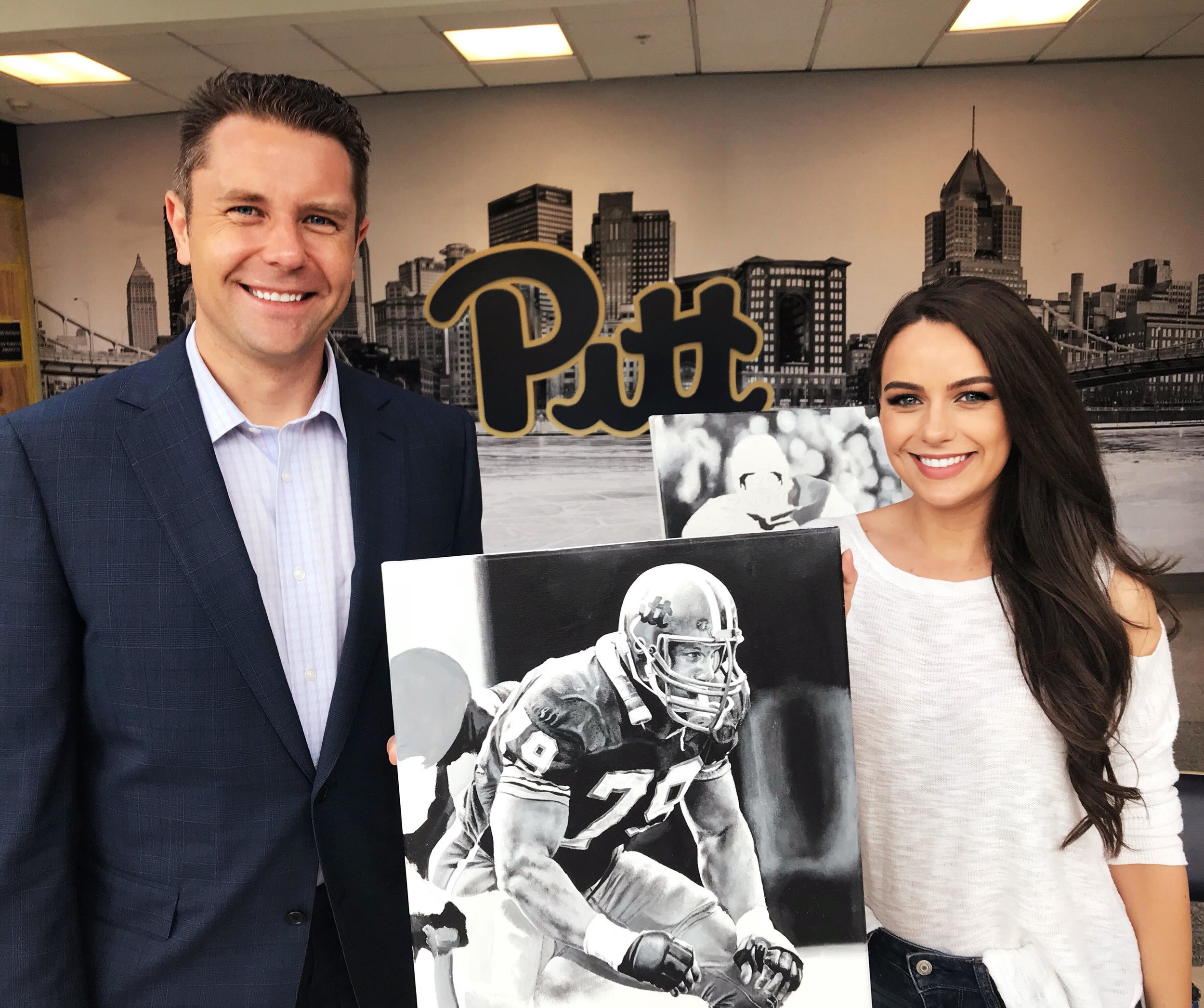 Kait Schoeb with WTAE sports reporter Ryan Recker following her interview with her Bill Fralic  painting
