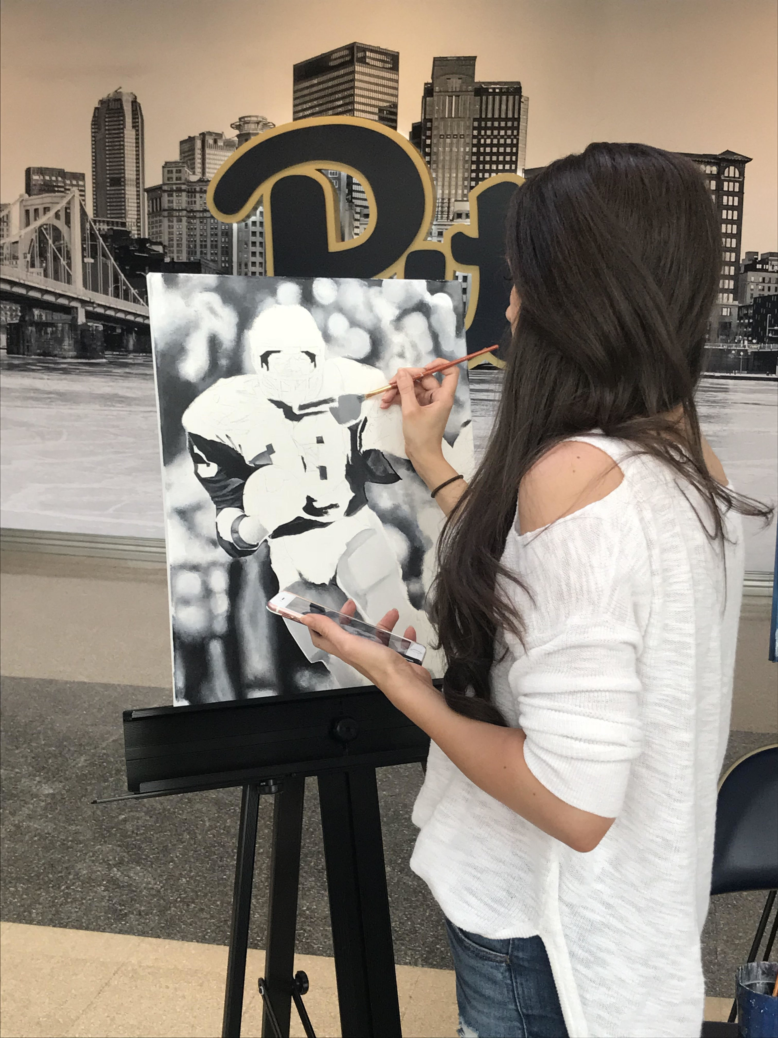 Kait live painting Bill Fralic portrait for WTAE interview