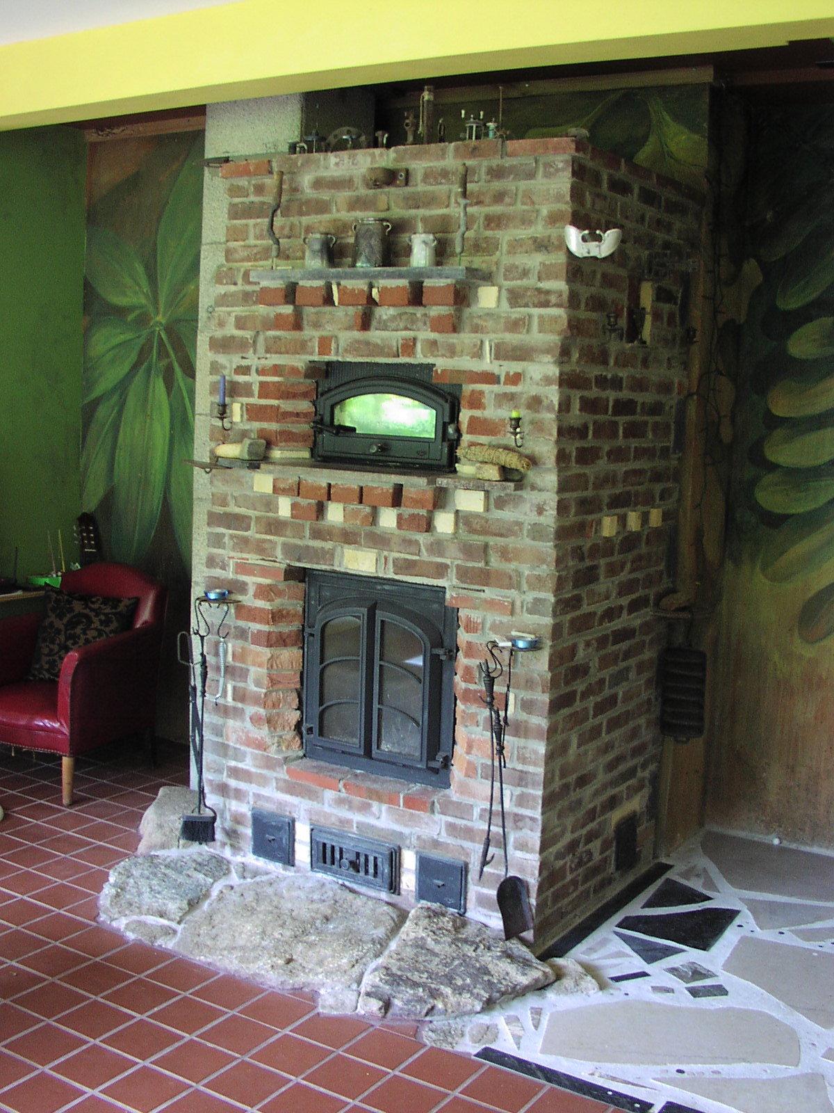 masonry stove with mural.JPG