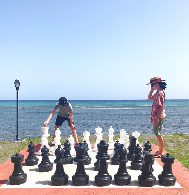 It's so much hotter than it looks in the photo, but the teens endured long enough for a game of beach chess.