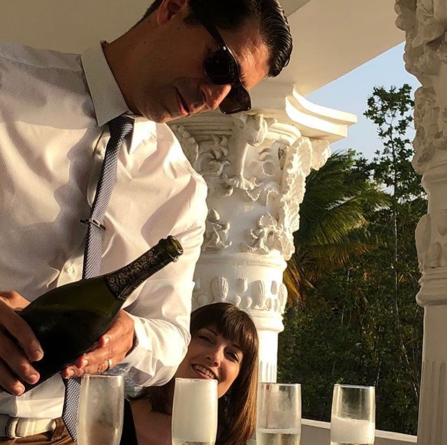 Last photo from our Jamaica trip and it might just be my favorite. 🥂 Patrick was pouring champagne to celebrate our friends' 16th anniversary, our 18th, and my 40th birthday. 📷: @boyle5150  #halfmoonjamaica