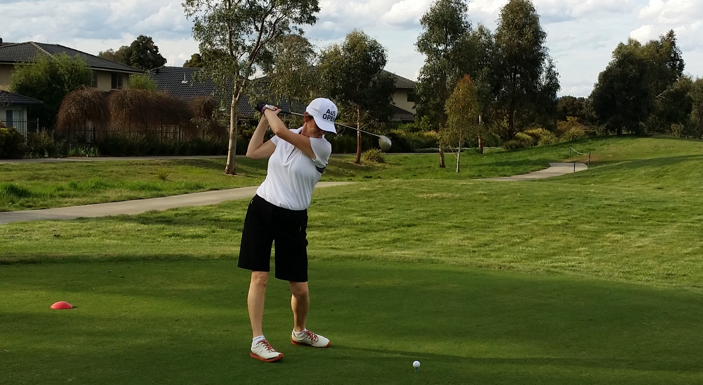 Golfing at the Sandhurst Golf Club in the outskirts of Melbourne. Can you spot what I'm doing incorrectly?