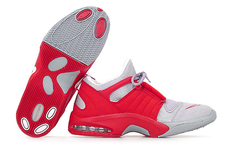 figure 1.  The Air Jet Flight's high wrapping midsole is visible here, as is the shoe's strategically placed TPU-support brace (the TPU is embedded within the strip of red material that extends along the base of the ankle). Both contribute to the Jet Flight's excellent on-court support and stability. On the bottom of the shoe, an internal TPU midfoot support shank is visible through the oval cut outs in the Jet Flight's outsole, which, by the way, provides epic traction.