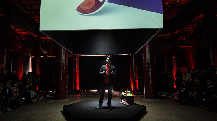 This rather dramatic photo shows me presenting at a product launch in Beijing, China, in the spring of 2014. Photo courtesy of Nike, Inc.