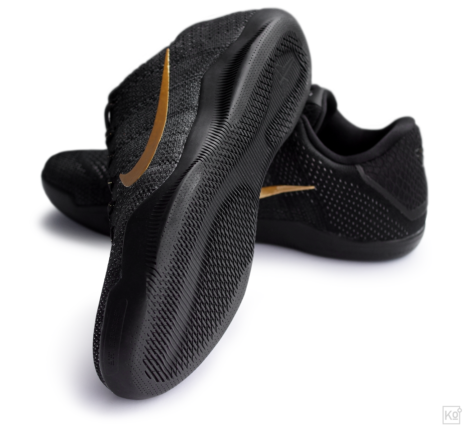 figure 7.  Beautiful outsoles have been a hallmark of the Kobe line, and the Kobe XI Elite's rubber holds to that tradition. What I particularly like about this iteration is the artful blending of lateral outriggers along both the forefoot and cuboid regions of the foot. This is a very elegant way to enhance lateral stability without adding a lot of bulk or weight to the shoe. I haven't spent enough time playing in the XI Elite myself to comment on traction, but the performance reviews I've read suggest that it can vary greatly based on your playing surface, with the XI's tread not faring particularly well on dusty courts.