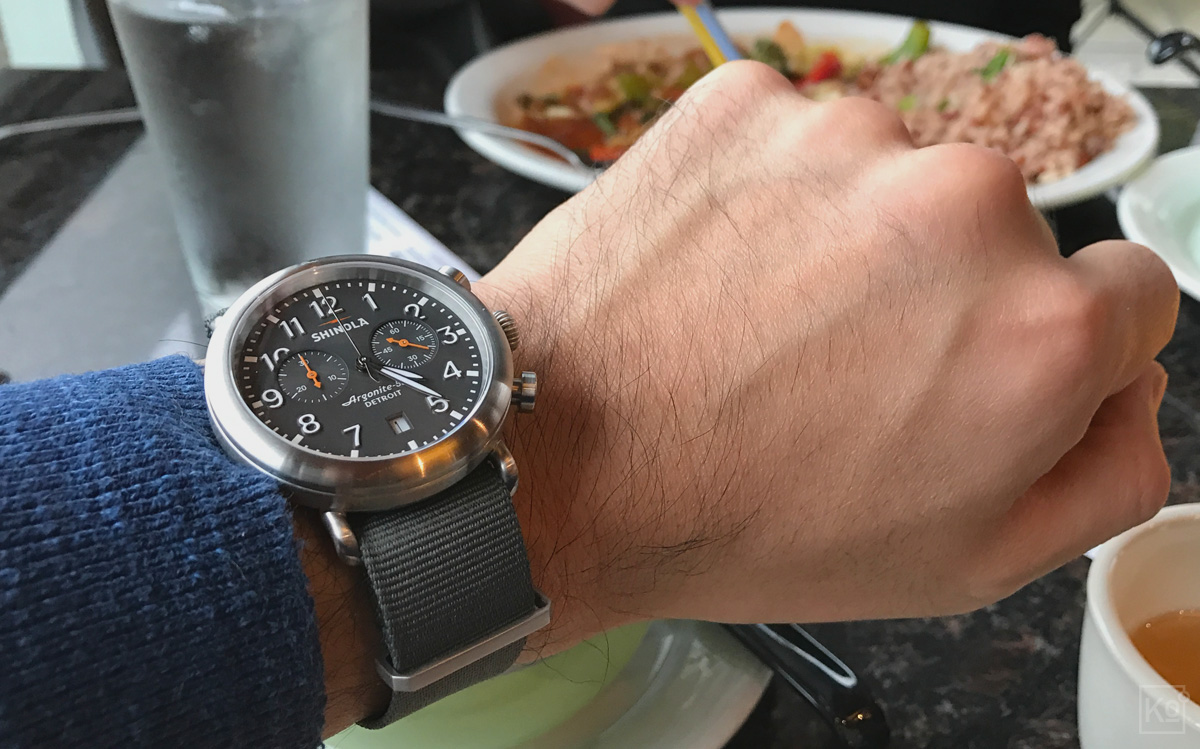 Here's the watch I fell in love with at first sight on a fateful night in November: The 41 mm Shinola Runwell Chrono with a cool grey dial and brushed stainless steel case. The Apple Watch feature I used most frequently was its countdown timer to time the steeping of my morning cup of tea and my afternoon cup of joe (brewed via a French press). As someone who knew nothing about watches at the time,I never even considered that an analog timepiece could fill that role without forcing me to perform mental gymnastics until I encountered the beautiful Runwell Chrono. I should note that the watch is shown here on a killer aftermarket NATO strap  from a company called ToxicNATOs —at just $18 USD, it was an incredibly cost effective way to personalize the watch to suit my style.