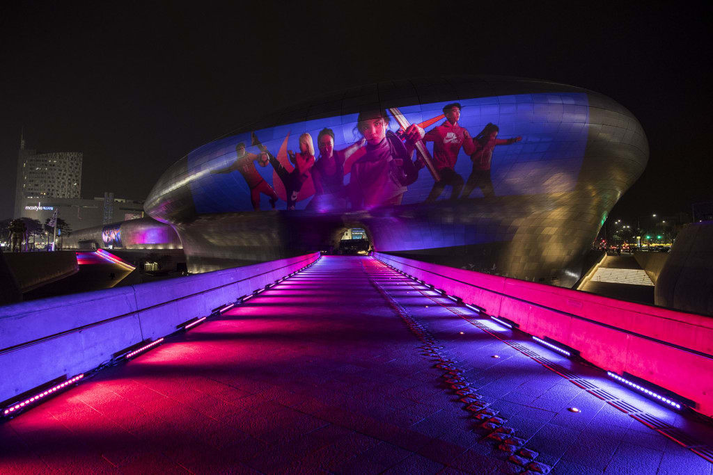 Dongdaemun Design Plaza in Seoul, South Korea, lit up to mark the launch of the first running footwear models to feature Nike React cushioning. Photo credit: Nike, Inc.