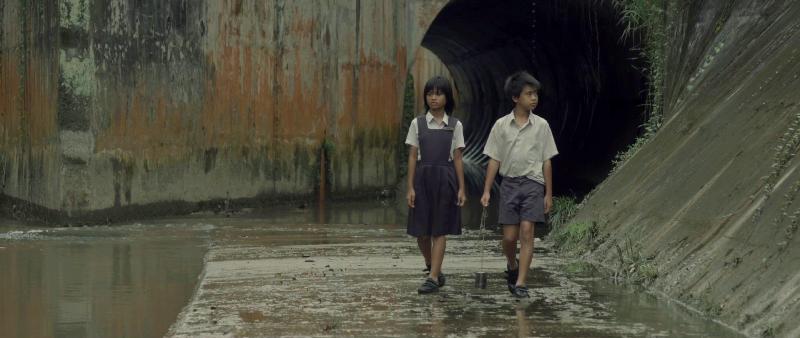 Still 1 - kids in longkang.jpg