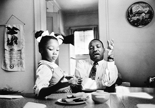 Dr. King with his youngest daughter Yolanda. Reminds us that we need to engage verbally with our children and get down on their level to remain relevant and relatable.