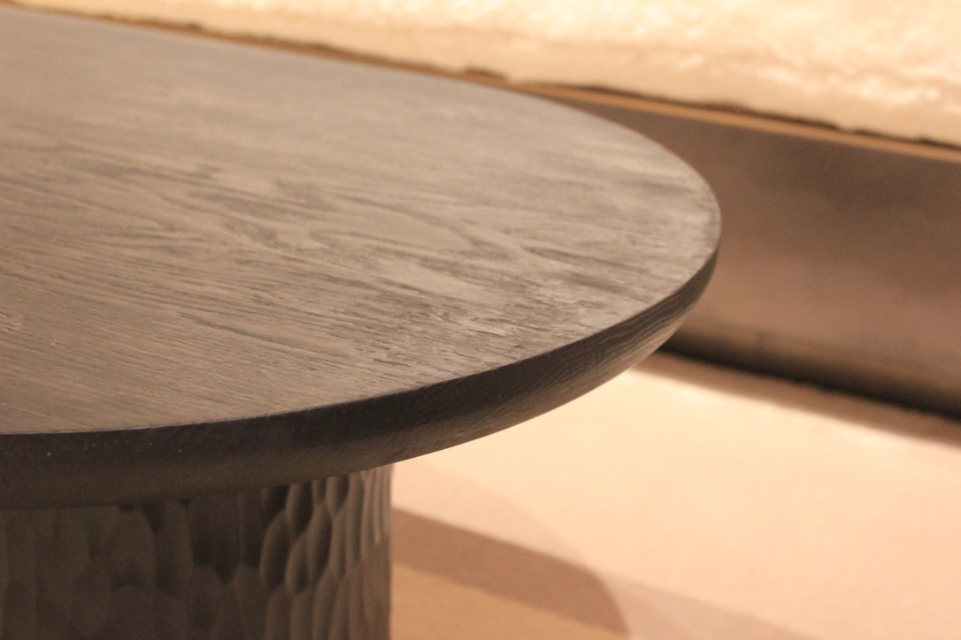 Burnt oak - Each table top is made using the highest quality european oak. To give the wood its distinctive charred black colour the oak is exposed to a intense and hot blue flame which chars the top layer of wood. This technique has been used for centuries by Japenese carpenters as it preserves the wood underneath. The finish gives the wood a beautiful colour while added and a unique texture. Due to the intense heat it has been exposed to In some lights the wood can gain a multicoloured reflection.