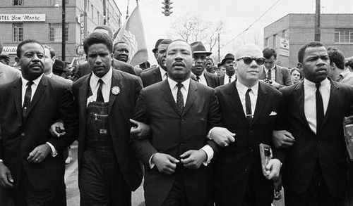 Dr. Martin Luther King, Jr (center) and John Lewis (far right) on the march from Selma to Montgomery, Alabama in 1965.