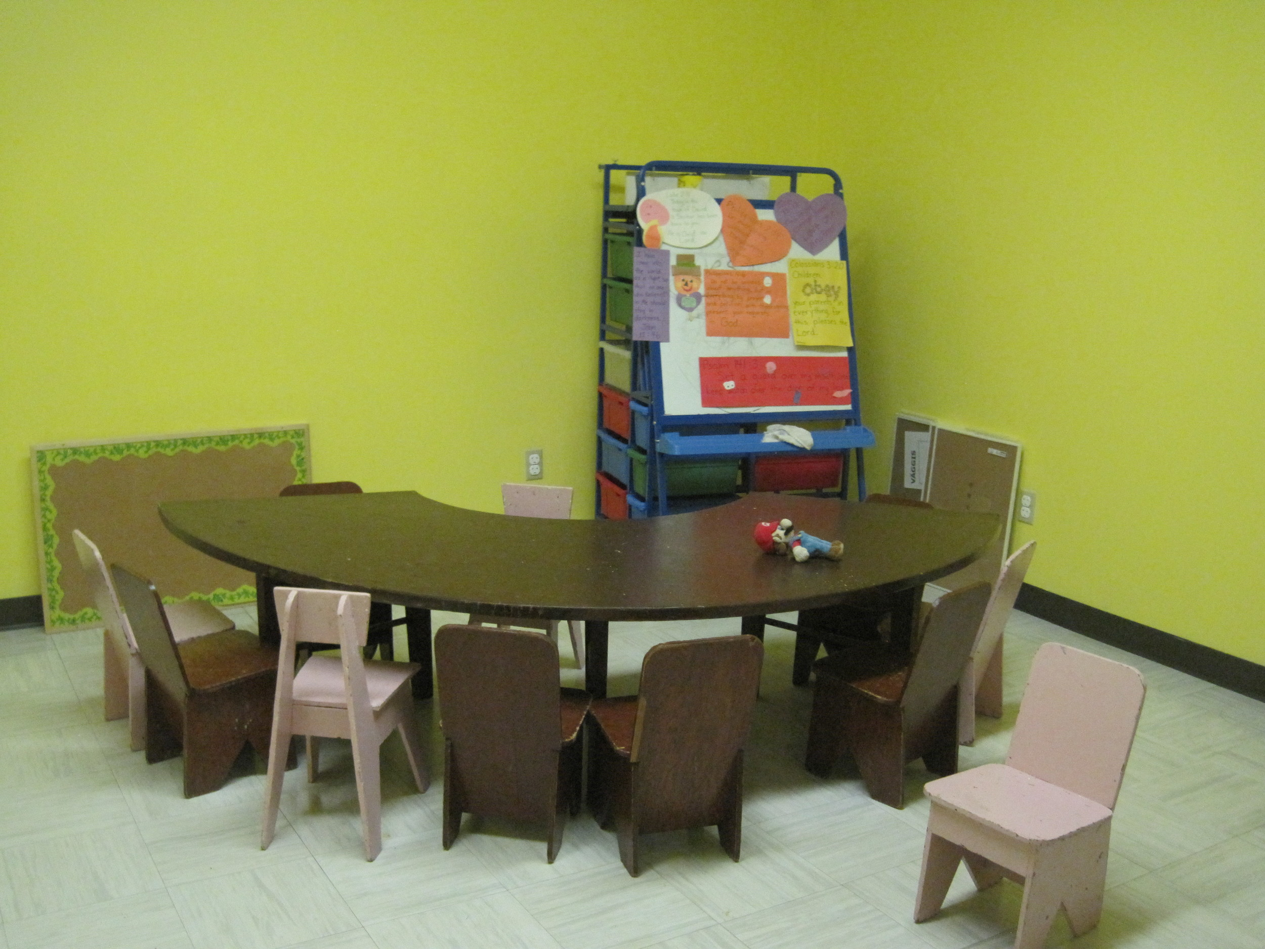 Our bright yellow Pre-K Sunday School room creates a welcome and inviting space for children to play and learn!