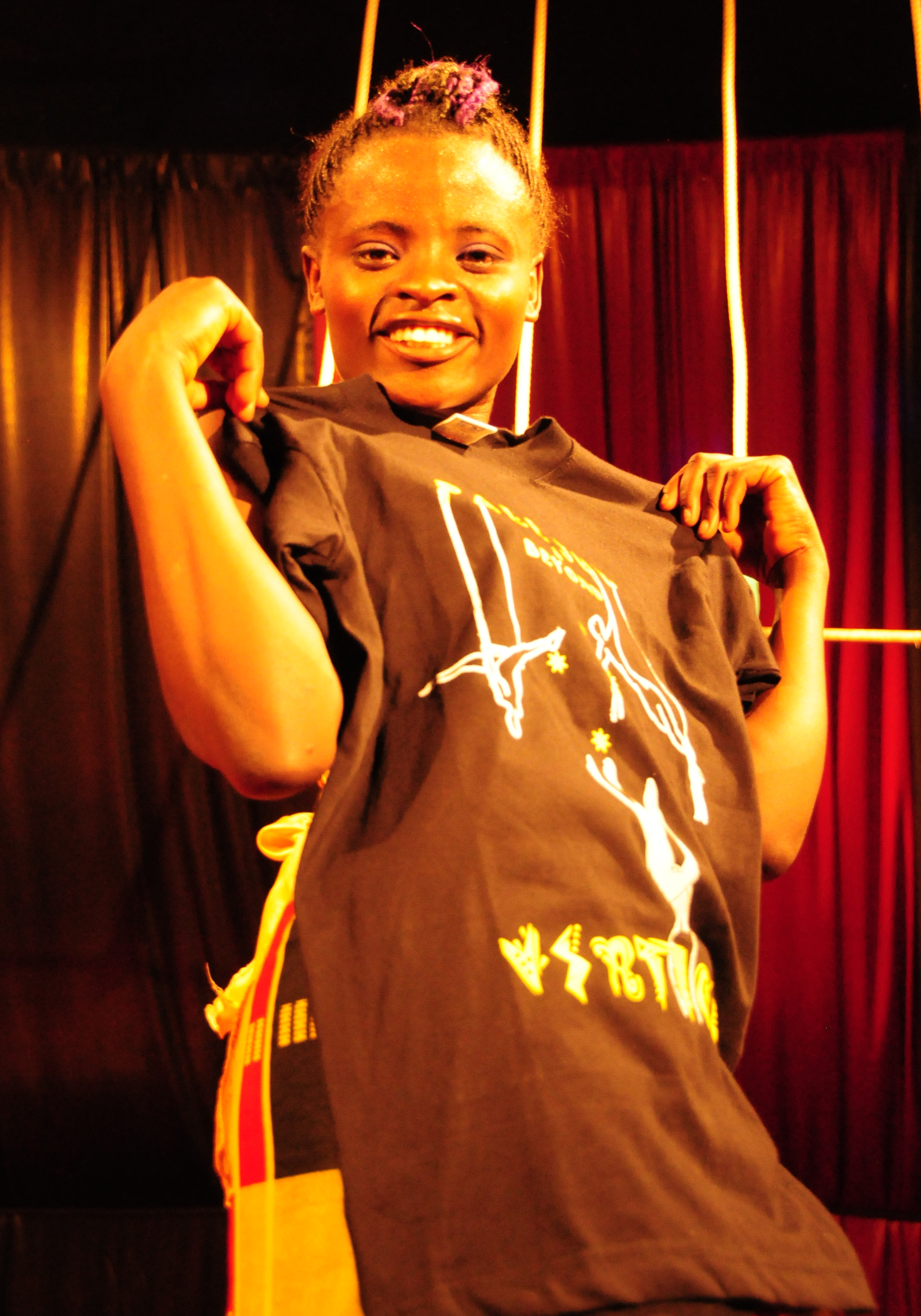 Nancy Wangari receiving training clothes