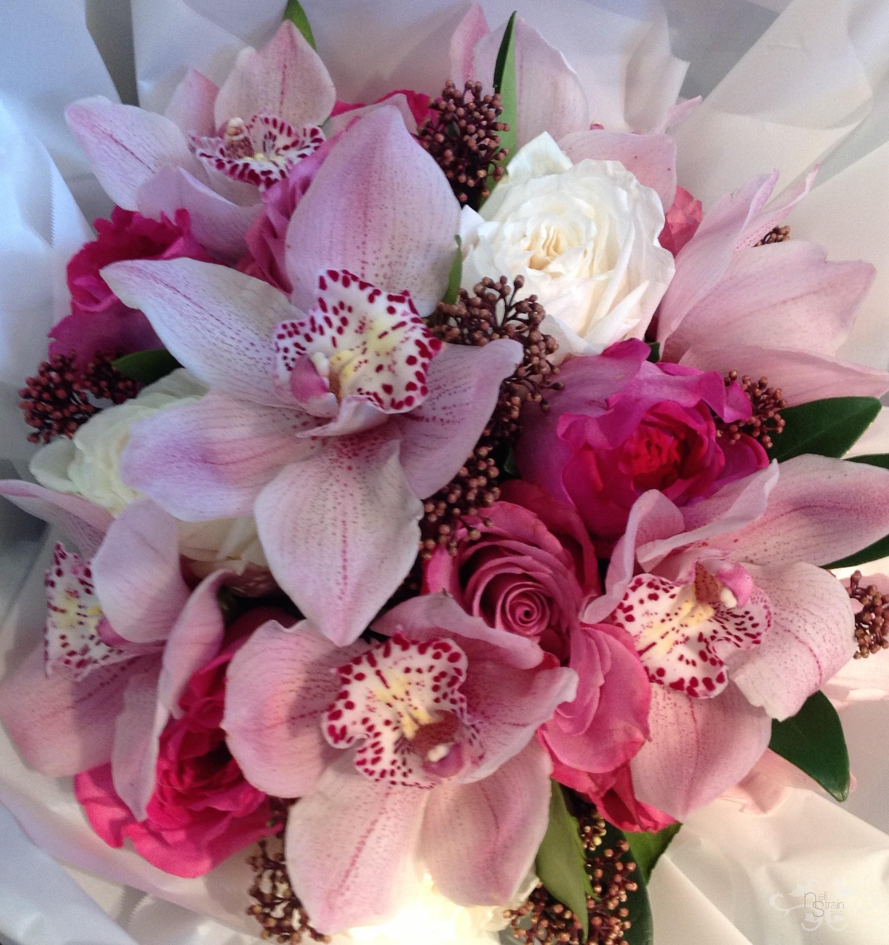 Roses, Cymbidium Orchids and Skimmia