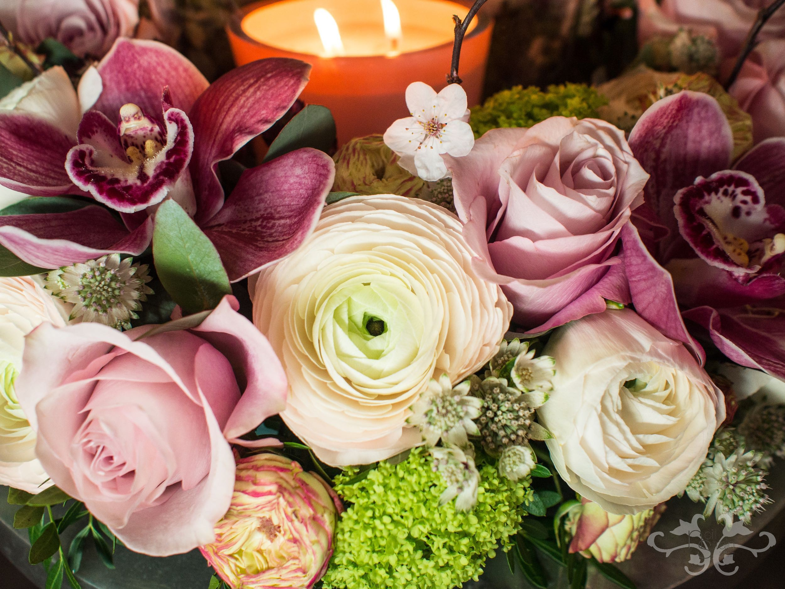 Roses, Renunculus, Cymbidium Orchids, Viburnum Opulus, Astrantia, Blossom. Photographyby John Nassari