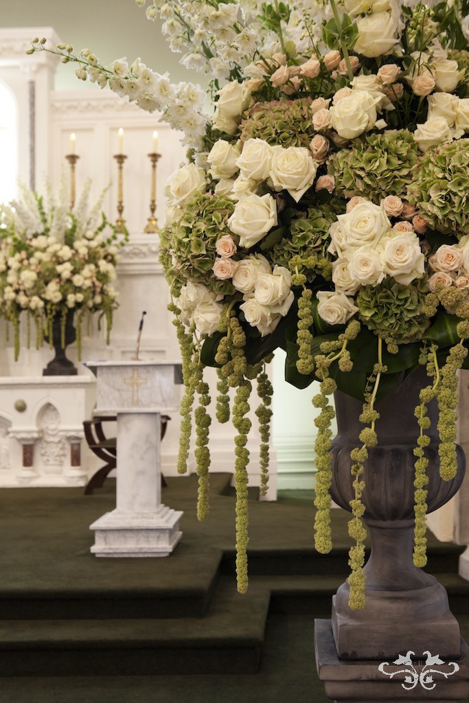 Groupings of Avalanche and Spray Roses are in proportion with the large heads of Hydrangea.