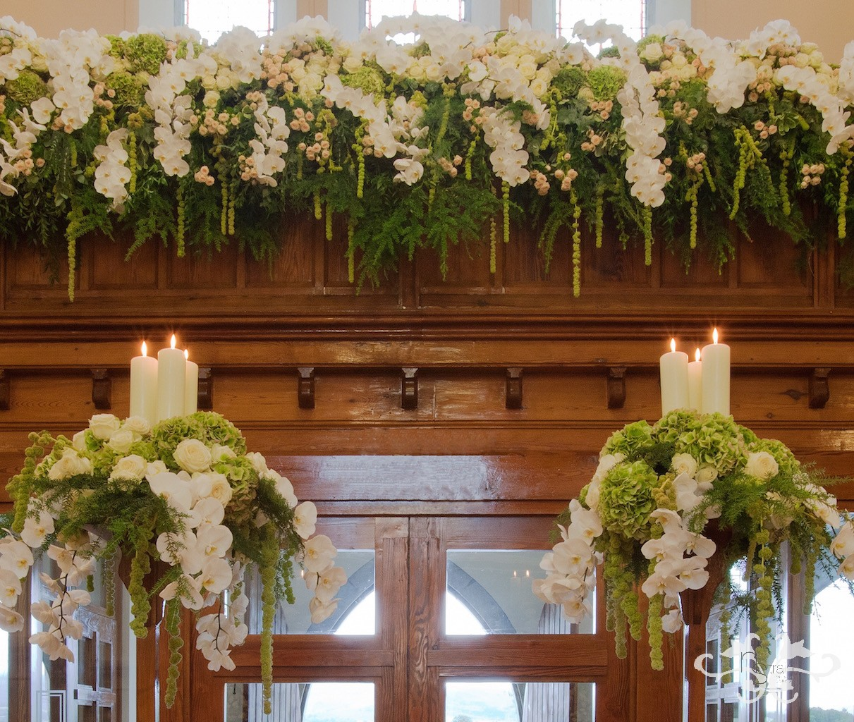The lavish floral feature on the balcony continues to bring one's eye up towards the high ceiling, accentuating the elegance of the church.