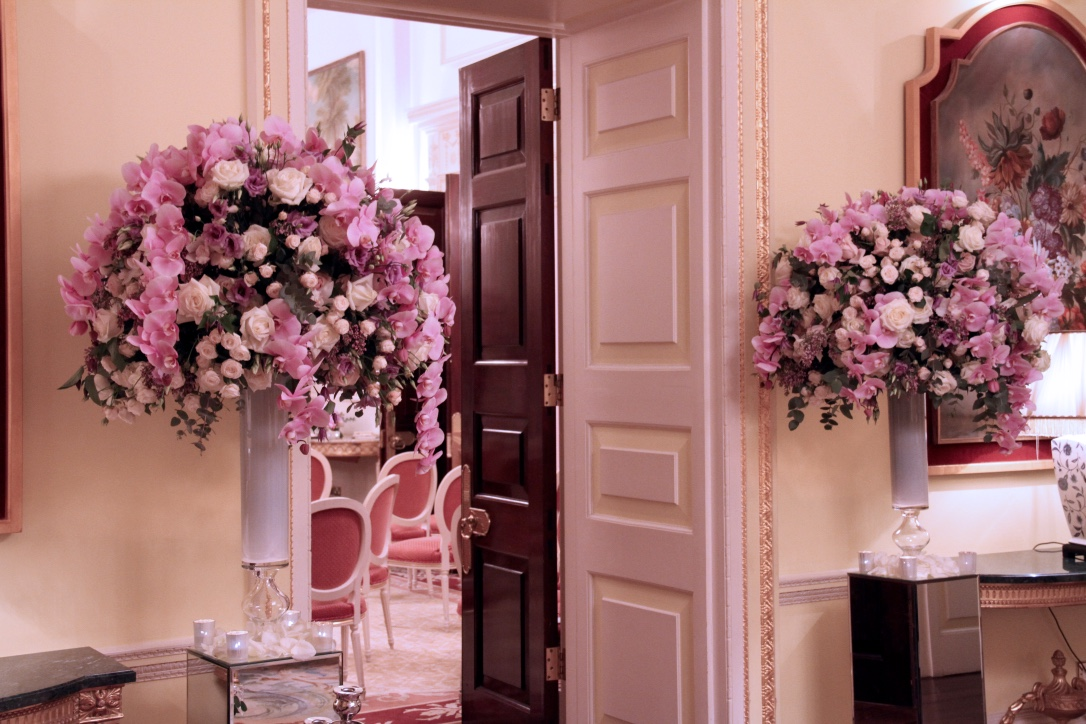 Framing the entrance into the Music Room, the flowers preview the urn arrangements inside.