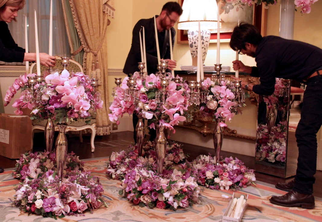 Final preparations to the table candelabra arrangements.
