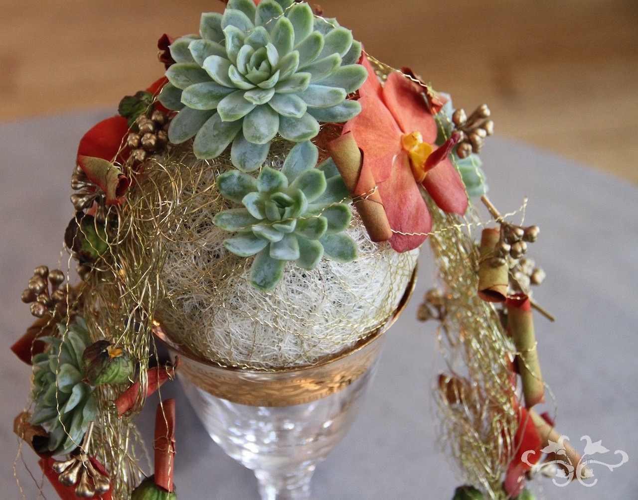 Succulents, Vanda Orchids, rolled petals and accessories make this hand-held pomander a fashion statement of great beauty