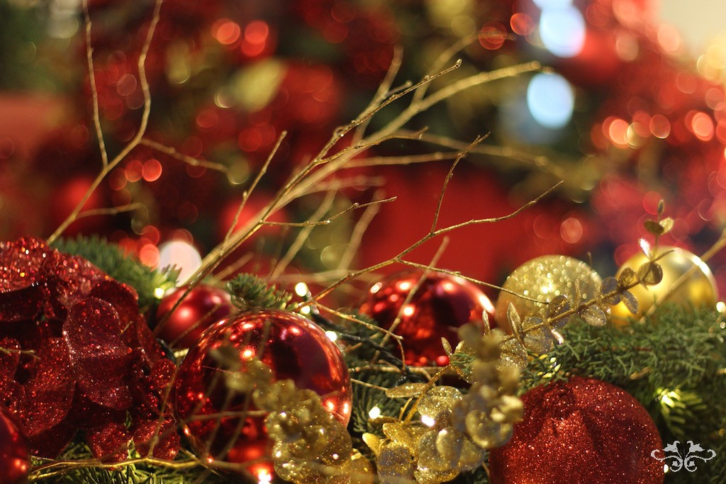 Glitz and sparkle, traditional red and gold with foliage and gold-sprayed twigs
